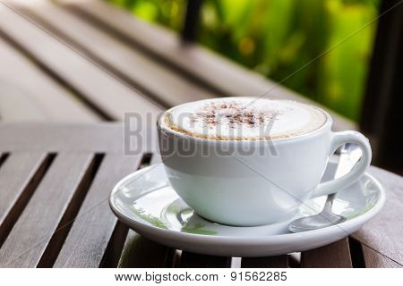 Cappuccino Or Latte Coffee On Wooden Table.