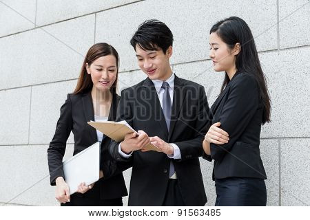 Business team read project information on clipboard