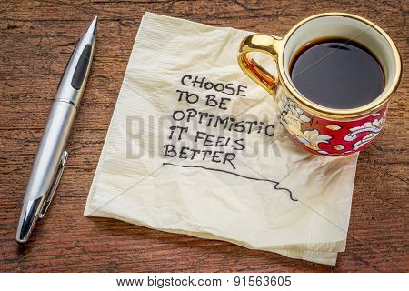 choose to be optimistic, it feels better - motivational handwriting on a  napkin with a cup of coffee