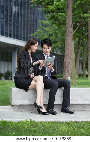 Businessman and businesswoman use of digital tablet together