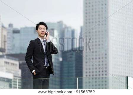 Businessman talk to cellphone at outdoor