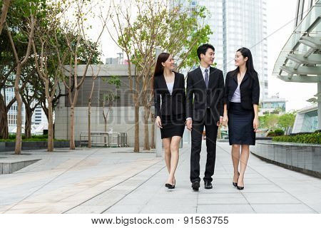 Group of business team mate walking on the street
