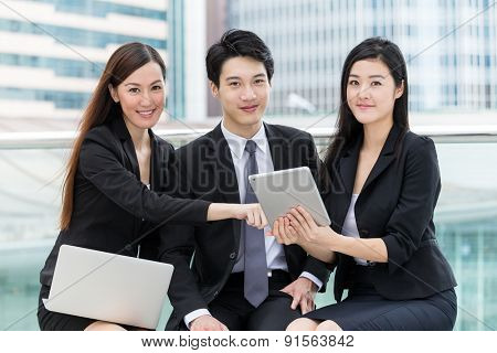 Businessman team mate using laptop and tablet together