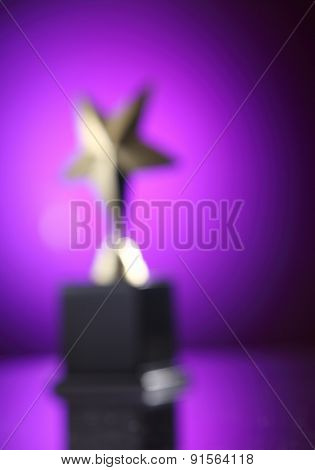 blur image of the star trophy- dream since too far away