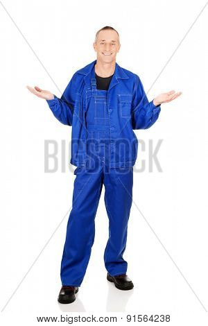 Full length repairman holding copyspace in hands.