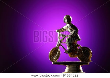 golden trophy on the purple background
