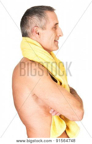 Side view mature man holding towel around neck.