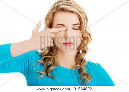 Portrait of a woman rubbing eyes.