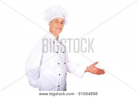 Experienced smiling chef showing copyspace on the left