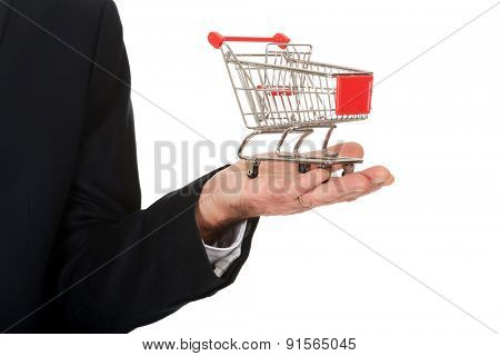 Close up businessman holding shopping cart