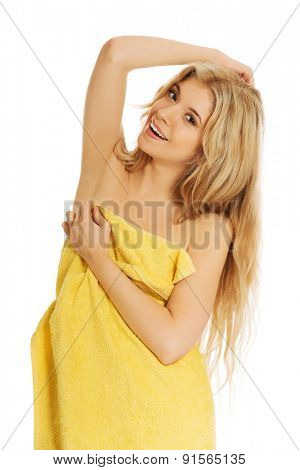 Smiling woman wrapped in towel.