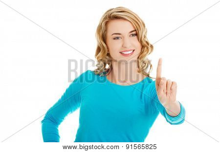 Portrait of woman pushing imaginary button.