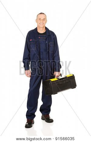 Full length worker with tools bag.