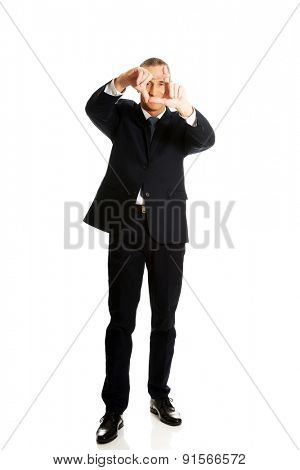 Full length businessman gesturing frame.