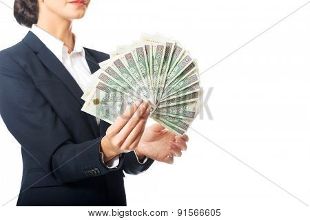 Portrait businesswoman holding a clip of polish money.
