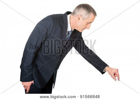 Side view businessman showing small size with fingers.