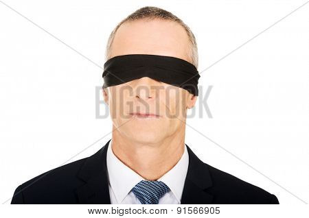 Portrait of a businessman with band on eyes.
