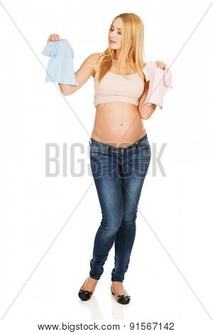 Pregnant woman with pink and blue baby shirts