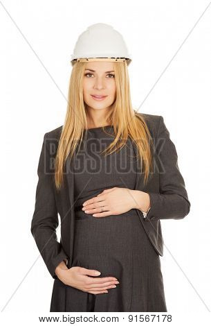 Pregnant businesswoman wearing a hard hat