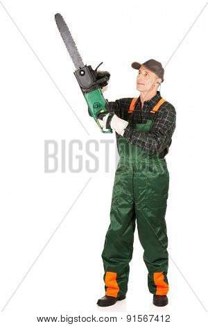 Mature sawyer in workwear holding a chainsaw.