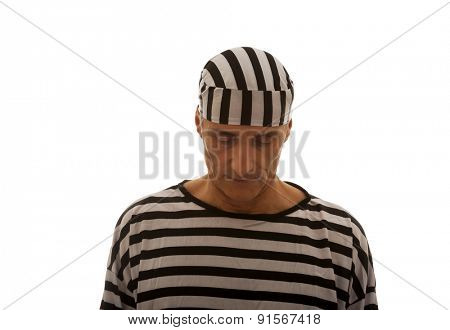 Mature sad man prisoner in striped clothes.