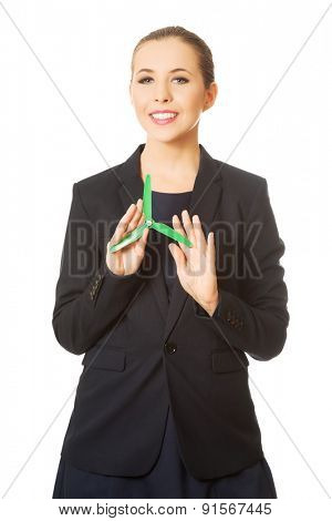 Beautiful caucasian business woman with green propeller. Isolated on white.