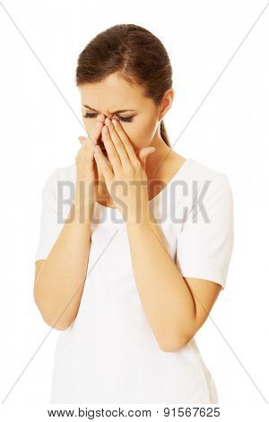 Young woman with sinuses pain