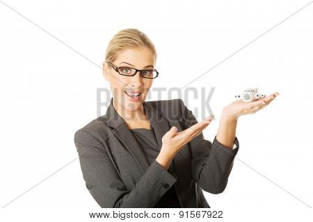 Beautiful businesswoman with plane toy in hand