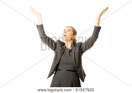 Beautiful woman raising arms high.