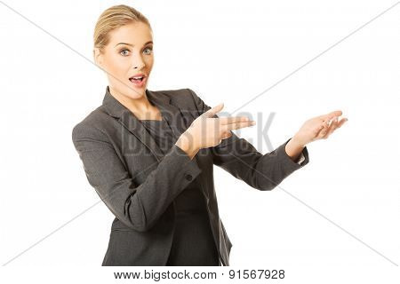 Business woman showing copy space.