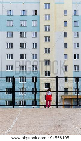 Little Girl And Modern Urban Apartments