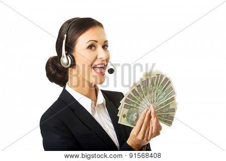 Portrait of call center woman holding polish bills.
