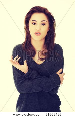 Young beautiful woman with folded arms