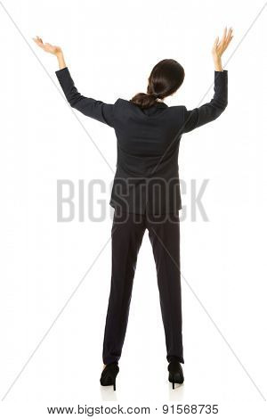 Back view businesswoman holding copyspace.