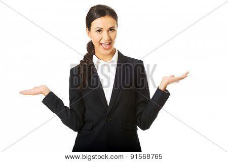 Portrait of businesswoman holding copyspace.