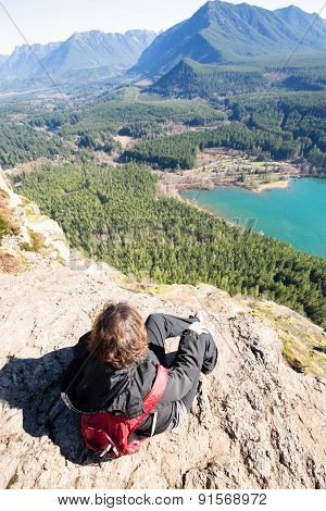 Woman Enjoying Rewarding View Of  Rattlesnake Ledge Trail