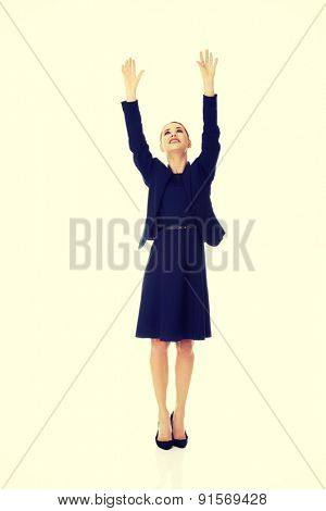 Beautiful businesswoman holding hands up