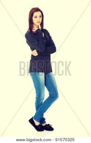 Young woman thinking about something abstract