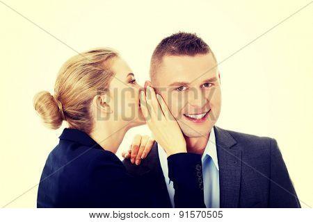 Woman share a secret to her friend