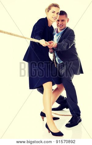 Business partners supporting each other by draging a rope