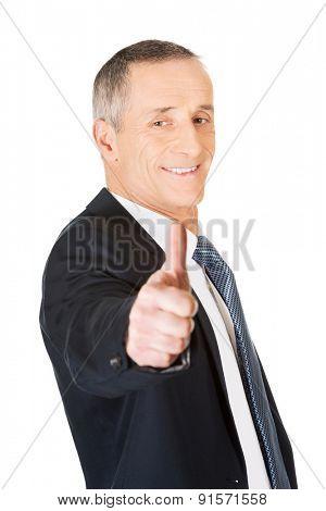 Portrait of businessman gesturing ok sign.