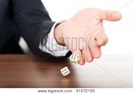 Close up male hand with dices on double sixes.