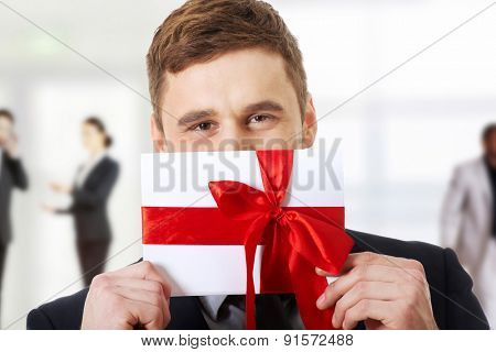 Handsome elegant man with valentines gift box.
