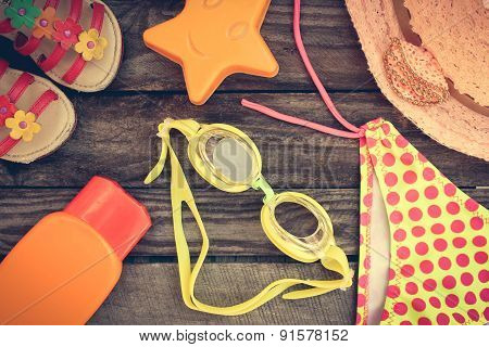 beach accessories on the old wooden background. Toned image.
