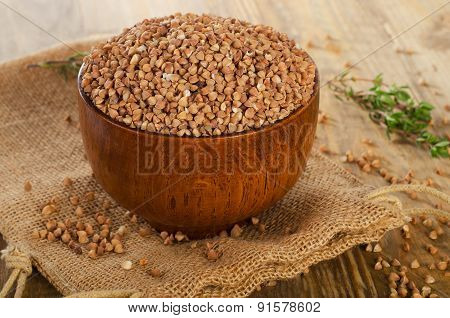 Buckwheat Groats On  A Old  Wooden Table.