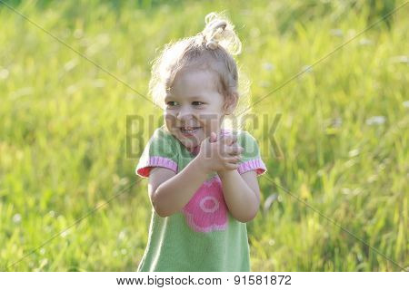 Portrait Of Laughing Two Years Old Preschooler Girl With Flinging Arms