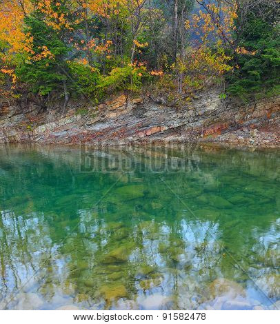 Crystal Clear Mountain Lake In Autumn