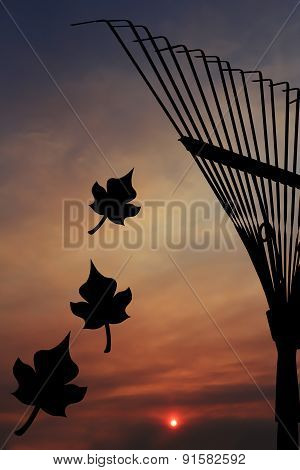 Garden Rake Silhouette In The Sunset