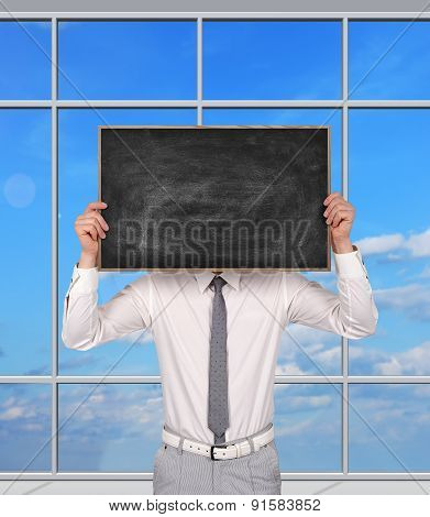 Businessman Holding Blank Chalk Board