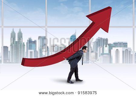 Businessman Carrying An Upward Chart